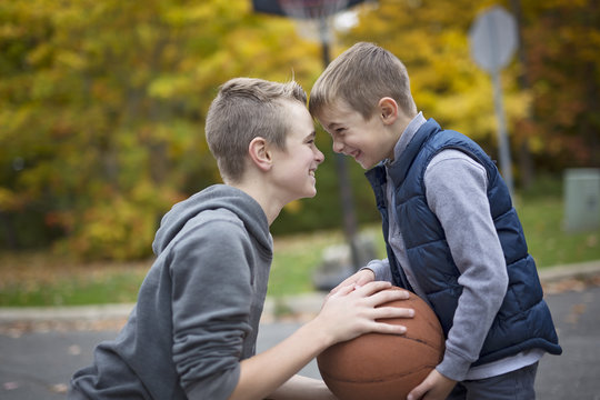 two boys with a basket ball
