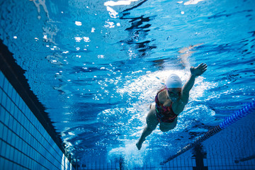 Fit female athlete swimming in pool