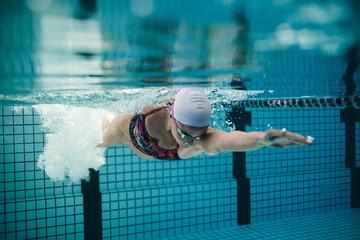 Female athlete swimming in pool