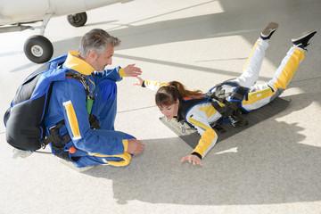 Woman practicing skydiving posture