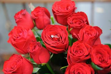 Wedding ring on the rose-bud