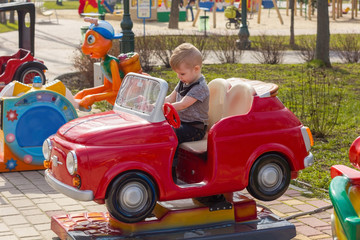 Little boy is riding the car