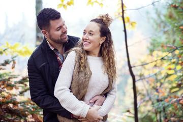 Nice couple having fun in autumn park