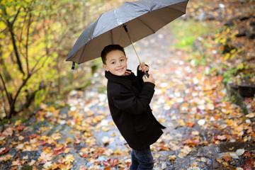 little boy in autumn october season