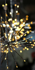 Brights LED lights garland stars snowflake, colorful light bulbs on a dark bokeh Christmas and Happy New Years decoration background