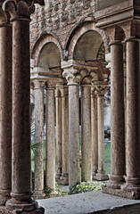 Columns and arches in the medieval cloister of Saint Zeno. Verona, Italy - HDR