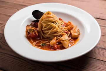Seafood spaghetti on white plate