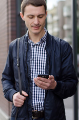Young man using his phone