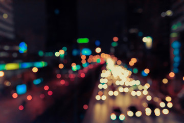 Abstract blur bokeh of Evening traffic jam on road in city. Vintage tone