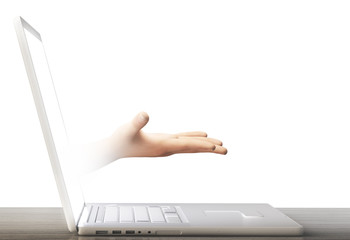 Computer portatile con mano che esce da schermo