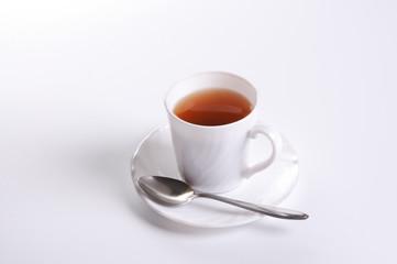 white mug of hot tea