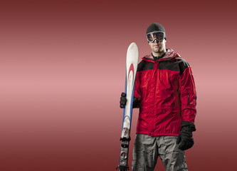 Skier holding a pair of skis