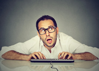 Man typing on the keyboard wondering what to reply