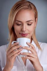 Pretty woman enjoying in coffee