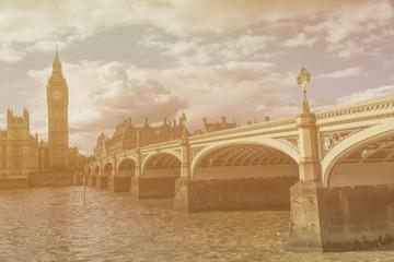 Big Ben with bridge against cloudy sky, London, United Kingdom