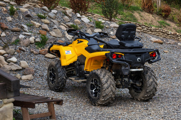 Yellow all-terrain vehicle. Yellow quadbike.