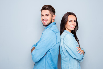 Cheerful hsppy man and woman with crossed hands standing back to
