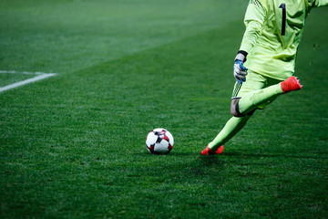Football, soccer goalkeeper knocks the ball during the match