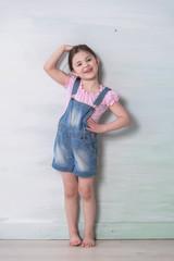 little girl measuring her height