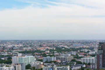 View many buildings, sky and white cloud.