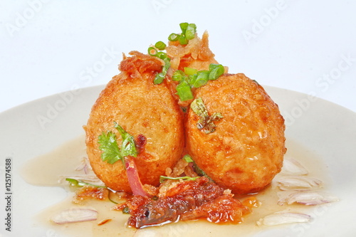 Fried hard-boiled eggs with tamarind sauce call as Khai Luk Keoi in ...