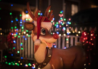 Rudolph the raindeer with bokeh of Christmas lights