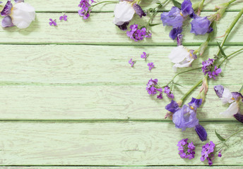 flowers on green wooden background