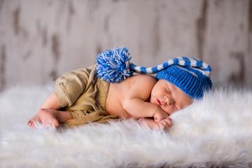 Boy kid newborn sleeping in blue hat