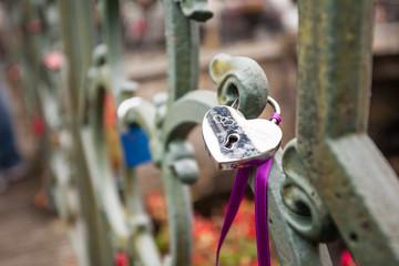padlocks to a bridge