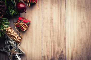Christmas tree with decoration on wooden background