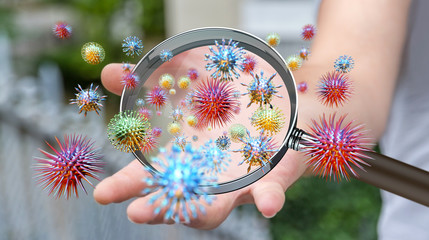 Close up on a sick man hand through magnifying glass transmittin Wall mural
