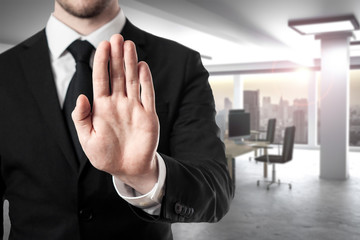 businessman in modern office hand stop gesture