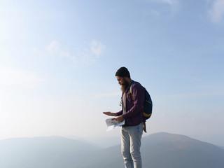 bearded man on mountain top