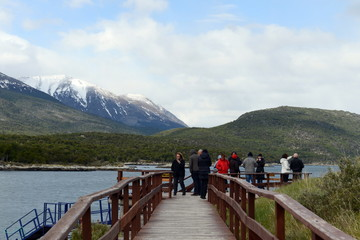Tourists in the Bay Lapataia in the national Park of Tierra del Fuego.