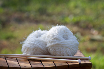 white balls of woll on a wooden chair