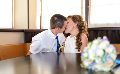 Selective focus of romantic newlyweds kissing
