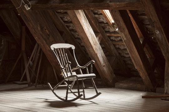 wooden rocking chair in attic