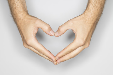 two caucasian hands in a gesture: heart for love