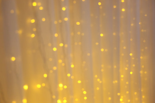 blurred yellow sparkle lights on a tulle
