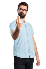 Handsome man with blue glasses coming gesture