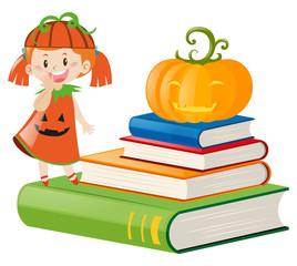 Little girl in pumpkin outfit