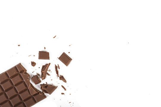 Cracked chocolate bar. On white, isolated background.