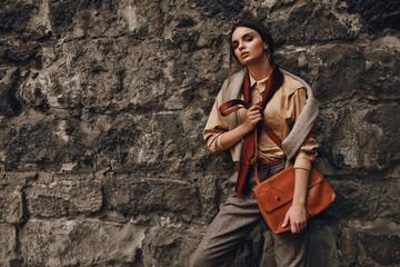 Beautiful Fashionable Woman In Fashion Clothing Posing Near Wall Wall mural