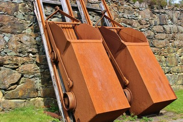 Two old copper tippers next to the copper mine of Visnes on the island Karmoy, Norway, Europe. The mine provided the copper for the Statue of Liberty in New York.