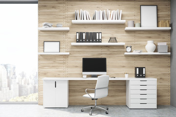 Home office with light wood panels
