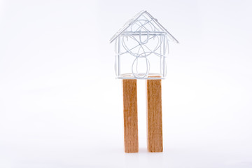 Little model house  on two domino pieces