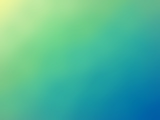 Abstract gradient green blue yellow colored blurred background