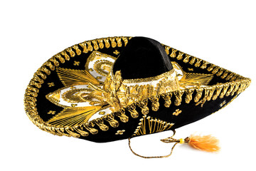 Black with gold ornate trim Mexican hat, sombrero isolated on white background