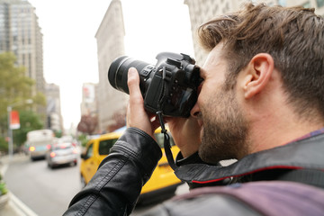 Tourist in New york city taking pictures with photo camera