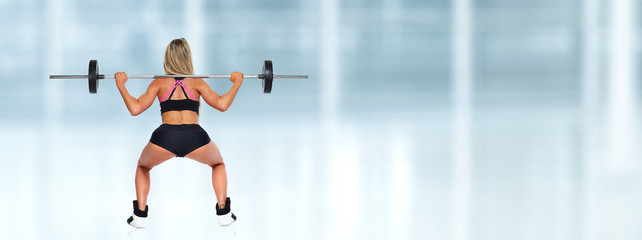 Woman squat barbell.